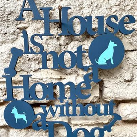 """Letrero """"A house is not a home without a..."""""""